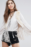 http://www.asos.com/raga/raga-the-nomad-faux-fur-fringed-waistcoat/prd/7484057?iid=7484057&clr=Eggshell&SearchQuery=waistcoat&pgesize=9&pge=0&totalstyles=9&gridsize=3&gridrow=2&gridcolumn=3