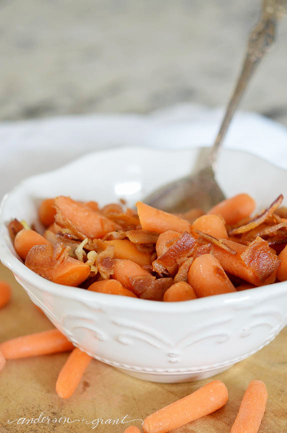 Baby carrots are turned into a special side dish with the addition of some sauteed onions and bacon.  |  anderson + grant