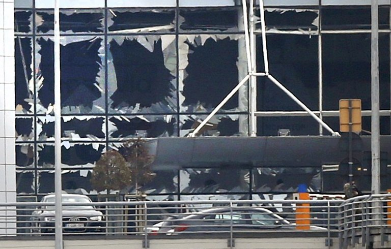 Broken windows seen at the scene of explosions at Zaventem airport near Brussels, Belgium