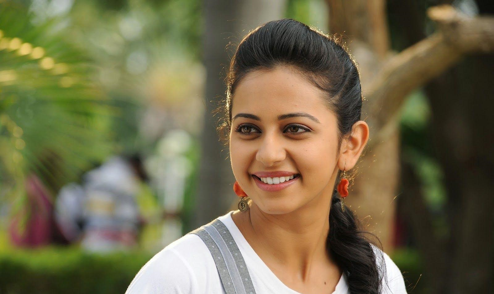 Rakul Preet Beautiful Smiling Stills In White Dress