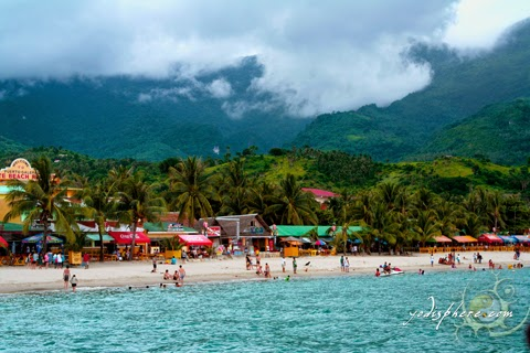 View of the white beach coast line of Puerto Galera
