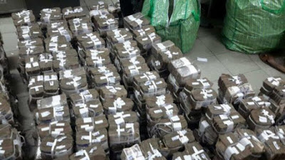 Court orders forfeiture of N449m found in Lagos shop to FG