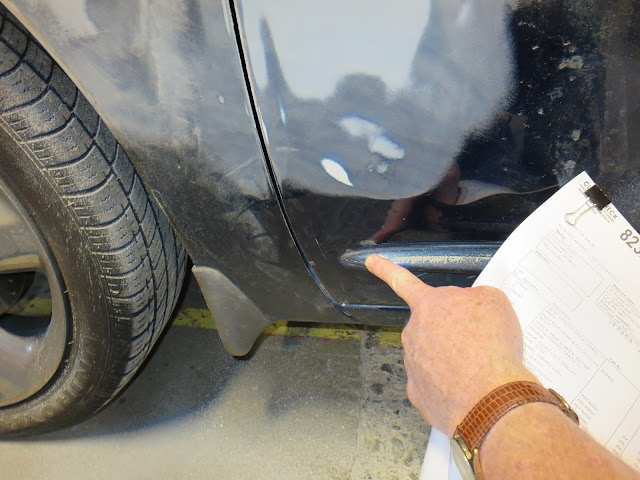 Fixing dents before paint job on 2003 Chrysler PT Cruiser.