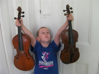 boy with decrepit violins