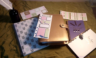 A collection of date books and organizers along with a few doll house miniature items.