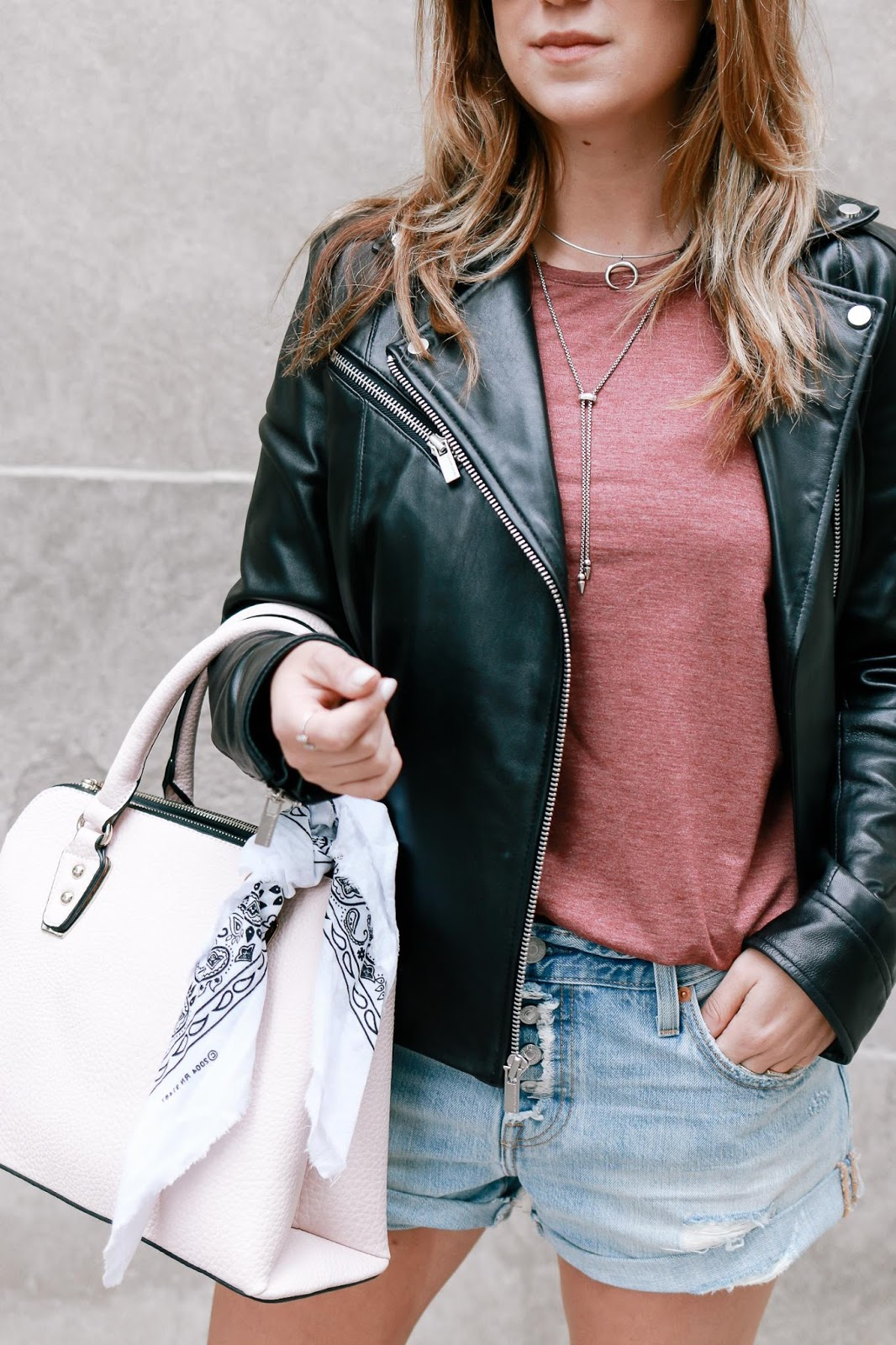 Picture of blogger, The Fashionably Broke, wearing the WILSONS LEATHER POLISHED CLASSIC LEATHER CYCLE JACKET.