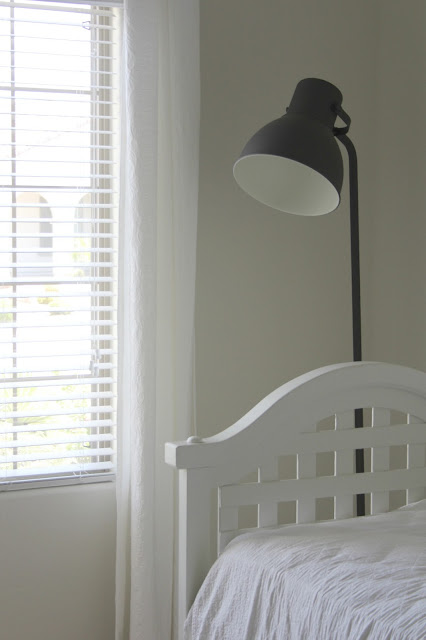 Vintage white daybed with Ikea Hektar floor lamp by Hello Lovely Studio