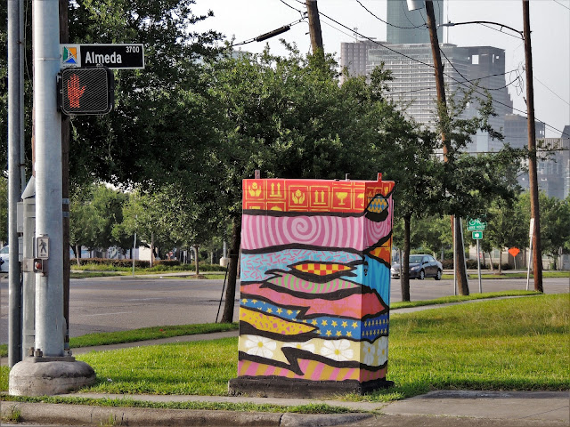 Beautified traffic control box on North-East corner with Downtown Houston Skyscrapers in the distance