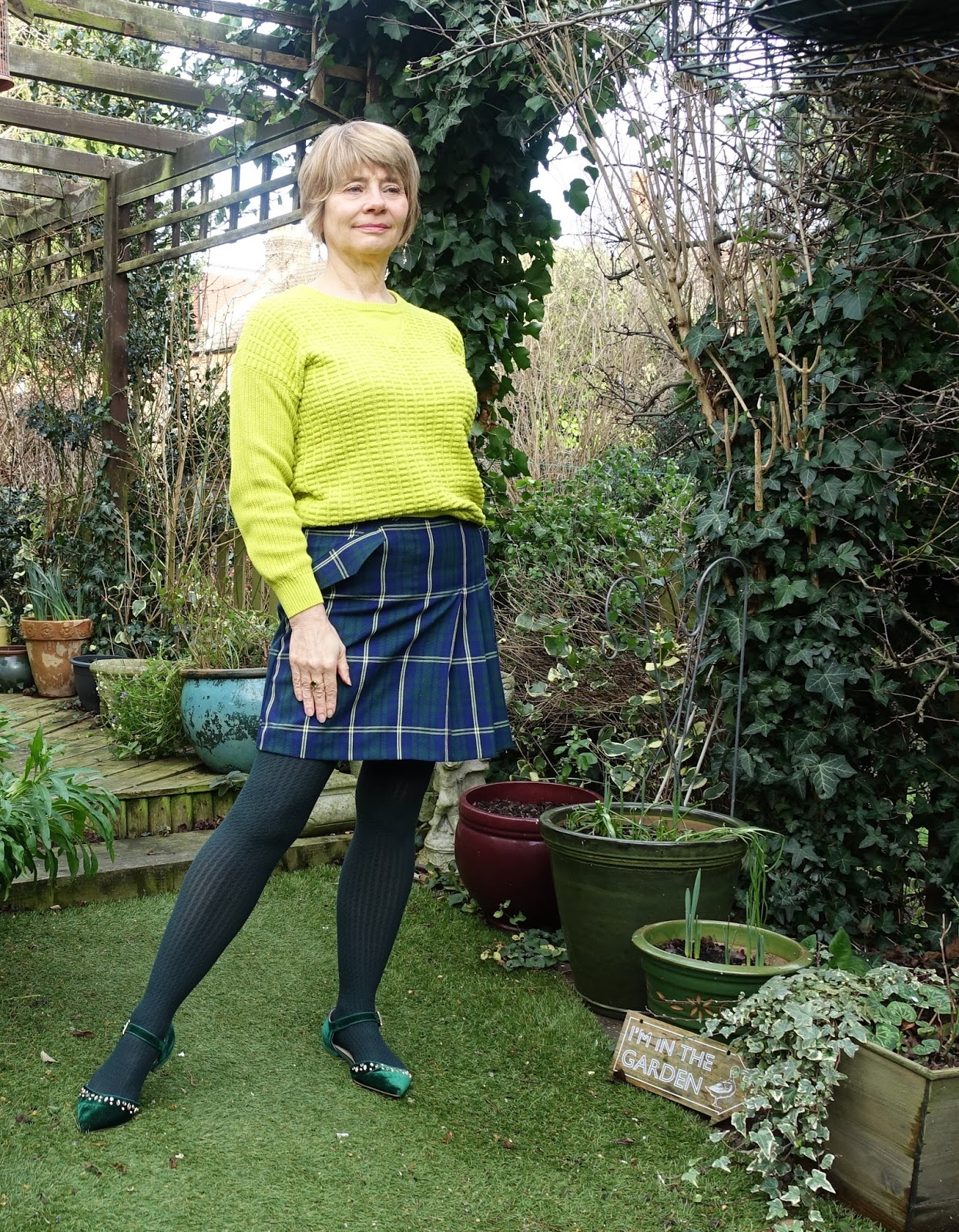 Image showing over 45s blogger Gail Hanlon in short plaid miniskirt from Sainsburys, green tights and green velvet shoes