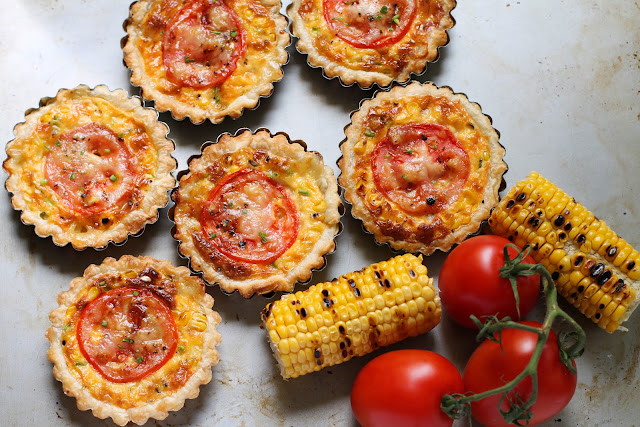 Food Lust People Love: These cheesy grilled corn tartlets boast grilled fresh corn, melty Saint Félicien cheese and a pretty slice of tomato on top, baked up in a flakey puff pastry crust. We ate these little beauties as a main course, alongside salad and green beans, but they would also be perfect for a special tea party or brunch.