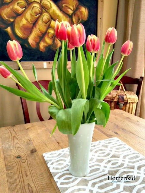 a vase of red tulips
