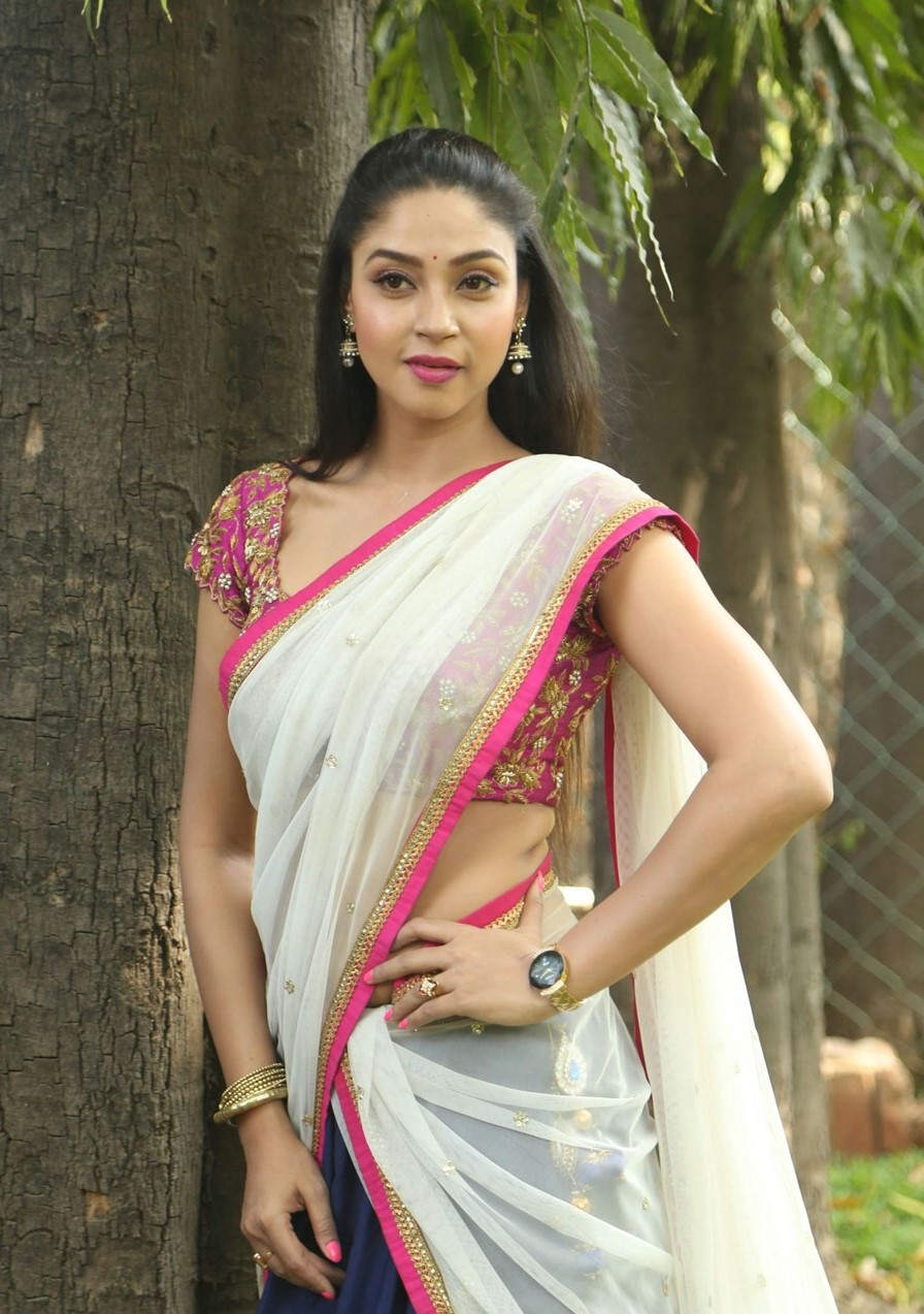 Actress Angana Roy Hot Hip Stills In White Lehenga Choli