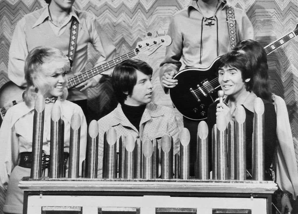 Curb (center) with members of the Mike Curb Congregation and Davy Jones on a television special in 1972
