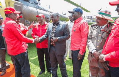 Isaac Ruto with Uhuru Kenyatta. PHOTO | PSCU