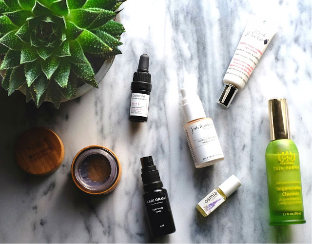 Skincare Essentials for a Weekend Away. Featuring 100% Pure Organic Coffee Bean Caffeine Eye Cream; Josh Rosebrook Tinted Nutrient Day Cream with SPF 30; Kari Gran Lavender Hydrating Tonic; Mahalo Rare Indigo Beauty Balm; Odacite Jojoba Lavender Serum Concentrate; Osmia Organics Spot Treatment; and Tata Harper Regenerating Cleanser.