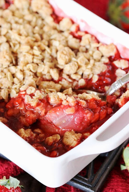 Fresh Strawberry Crisp is one perfectly simple, perfectly delicious dessert for strawberry lovers.  You'll want to keep this easy recipe on hand, for sure, to enjoy during berry season and all year round!  www.thekitchenismyplayground.com