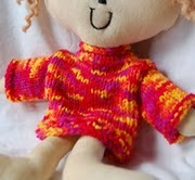 http://www.ravelry.com/patterns/library/doll-bear-sweater