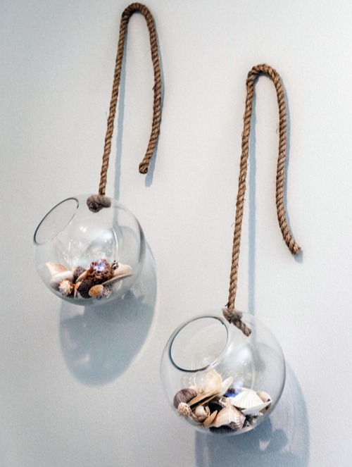 Filled Glass Globes Hung from Wall
