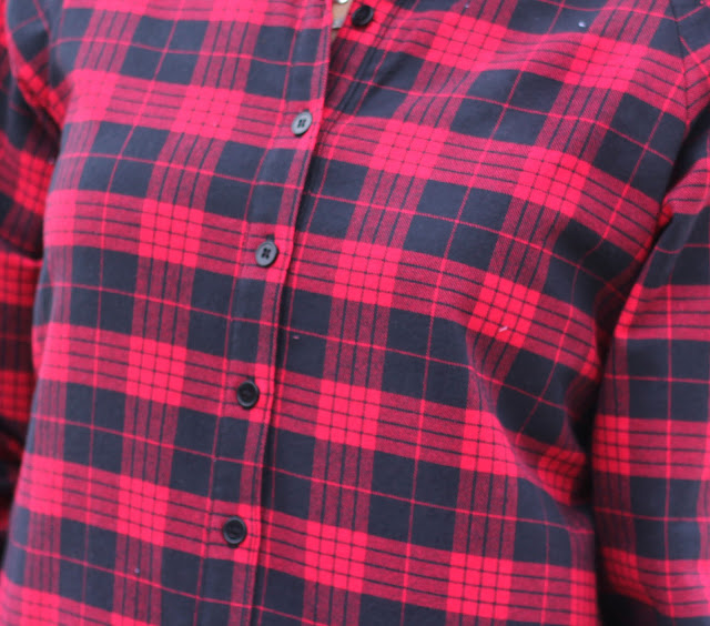 McCall's 7472 Shirt from Mood Fabrics' Red Tartan Plaid with front band and black buttons