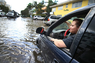 In Miami Beach, high tides are creating street flooding problems more often as sea level rises. The U.S. Southeast is seeing the fastest acceleration in high-tide flooding days. (Credit: Joe Raedle/Getty Images) Click to Enlarge.