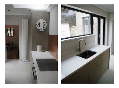 remodeled kitchen with views through new window to courtyard. cb3 design. Peebles. Scottish Borders. Architects