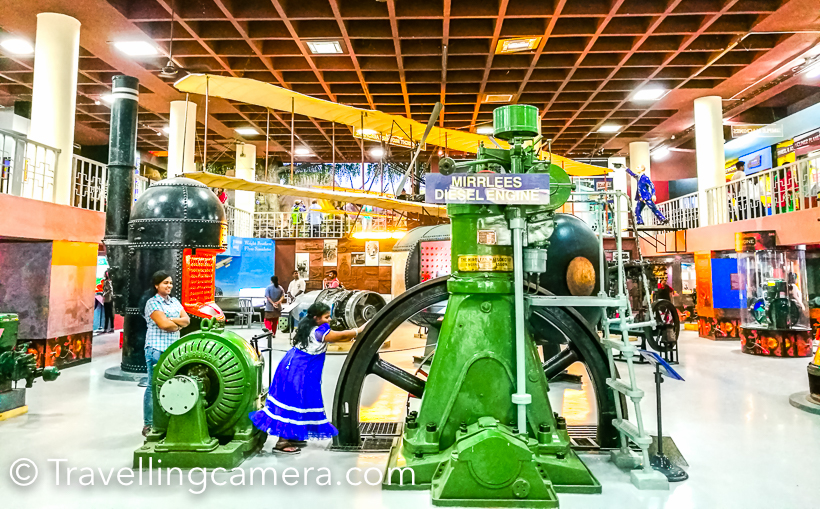 During my recent visit to Banglore, I visited Visvesvarya Industrial & Technology Museum and am super impressive with this place. I strongly recommend this to all kids. So if you are travelling to Bengaluru or state in the city, make sure you take your kid to this place once. Thereafter kids would drag you there once in 3 months at least :) . This posts shares more about the place and why I am so impressed.     This place is adjacent to Art Museum and very close to Cubbon Park & Karnataka Aquarium. The place is free for kids and adults need to buy 40 Rs ticket which is very nominal in my opinion. During the weekends this place is pretty crowded, but since whole museum is spread over 5 floors of this building, there is enough space for everyone to look through each installation to learn and enjoy.     There is huge space inside this building which is dedicated to museum. And you can see a huge mig fighter plane in the front yard.     On ground floor, there are various mechanical demonstrations of some common things we use in our lives.     There are some very interesting setups. The zig-zag structure is very popular. Some balls keep moving on them and change their paths as per guided bends. One has to see it to really appreciate the whole setup.     I would leave you with these visuals and feel the energy of this place. I don't have right words to explain it well. Please note that most of them are working models and you can play with them.        Even this zip opens and closes, which can be controlled by the wheel in the bottom part of photograph.