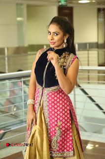 Telugu Actress Sri Reddy Mallidi Stills in White Beautiful Dress at Marriage Needs Bridal Fashion Week 2017 Logo Launch  0166.JPG