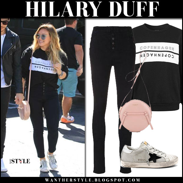 Hilary Duff in black sweatshirt topshop, black jeans j brand and sneakers golden goose october 15 2017 street fashion