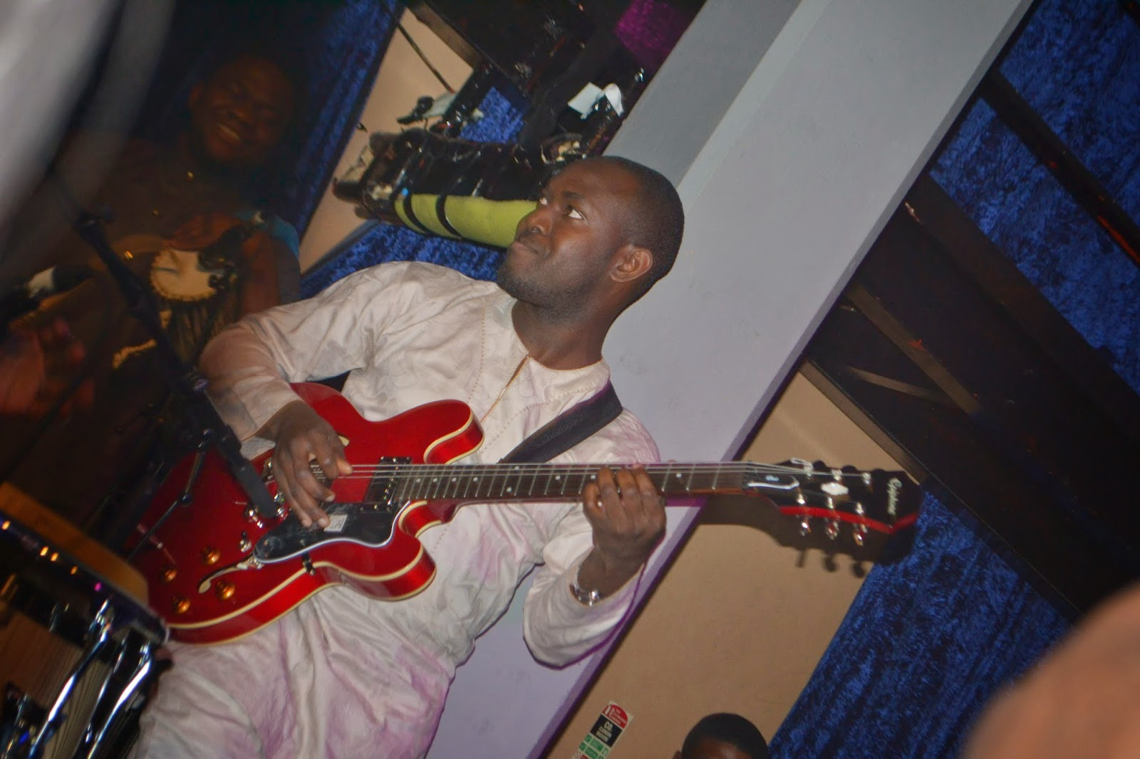 Black Guy playing a Red Guitar