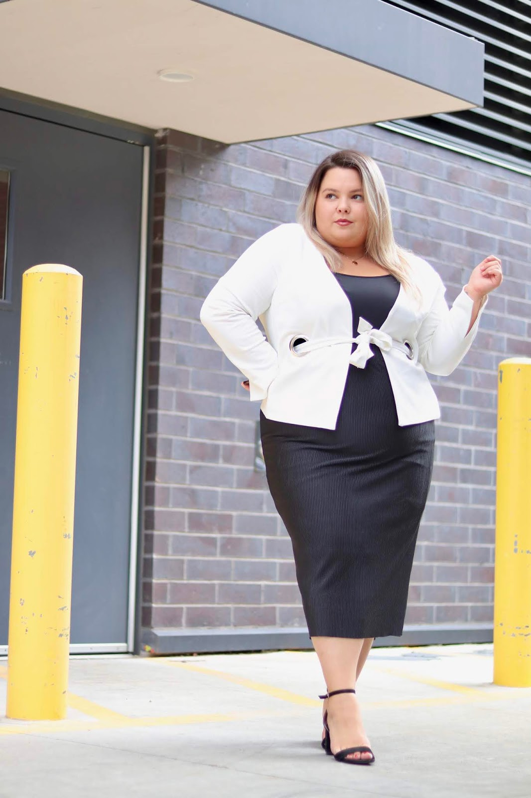 Chicago Plus Size Petite Fashion Blogger, influencer, YouTuber, and model Natalie Craig, of Natalie in the City, reviews Soncy's Ribbed Pencil Skirt and Tie Another Day Collarless Blazer and work attire.