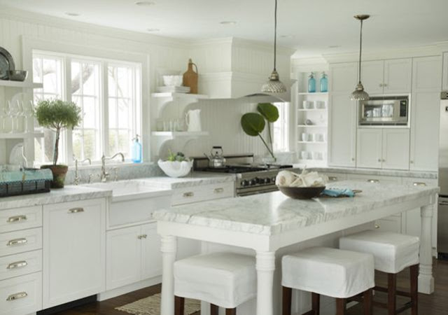 white kitchen long narrow island marble chrome hardware