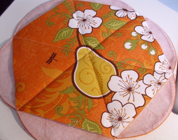 Fold Each Curve Over Raw Edges And Blanket Stitch Quilt To