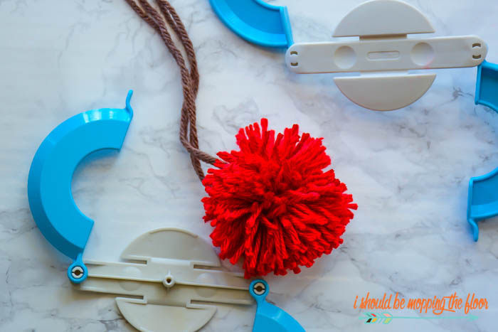 Easy Yarn Pom Pom Apples | These fun little pom poms have a cute apple twist to them...perfect for back-to-school or even fall decor!
