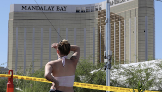 A day after a massacre, Vegas is not quite Vegas
