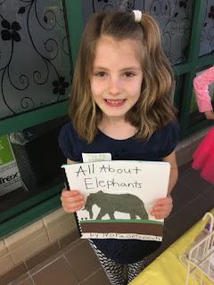 student with their book on elephants