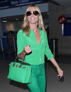 Heidi Klum wearing green round 5.jpg