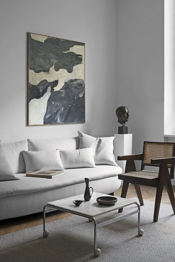 Neutral shaded interiors with impressive art by Claes Juhlin