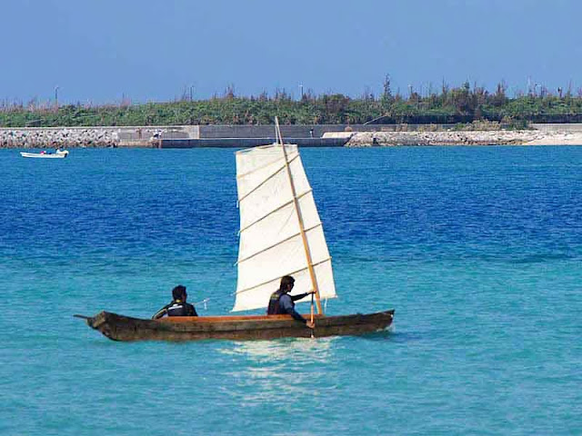 two man sailing sabani boat