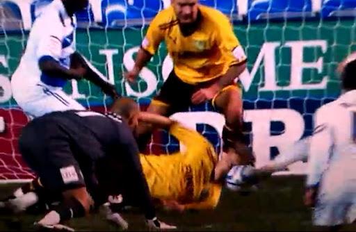 Burnley defender Ben Mee uses his head to prevent Reading's Noel Hunt from scoring