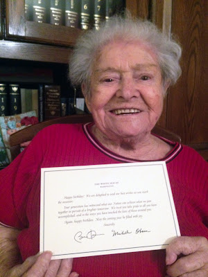 My Oma proudly holding up her official White House greeting for her 95th birthday; July 2015.