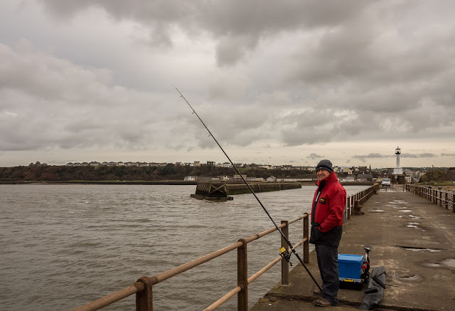Photo of Phil fishing on the pier at Maryport
