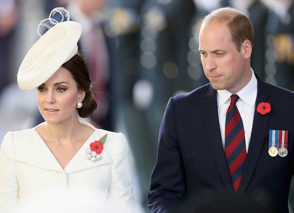 Kate Middleton wore Alexander McQueen cream coatdress. Anne Grand-Clement clutch, Balenciaga pearl earrings. Mathilde Natan lace dress