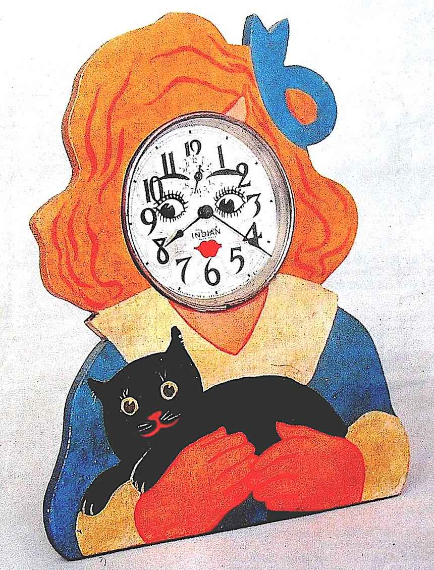a 1930s child's clock, strange unusual odd weird, black cat