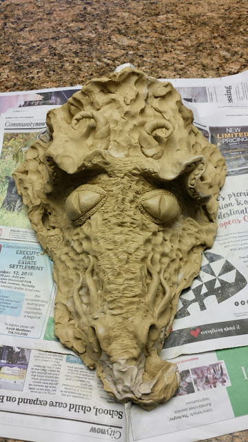 Pottery / stoneware dragon mask by Lily L, in progress.