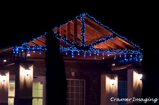 Hotel entrance decorated with Christmas lights for the holidays by as photographed by Cramer Imaging