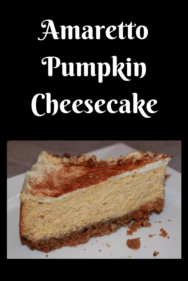 this is how to make an amaretto pumpkin cheesecake from scratch with pumpkin puree, cream cheese and baked into a pecan crust in a spring form pan