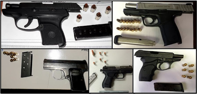 Loaded firearms discovered in carry-on bags.