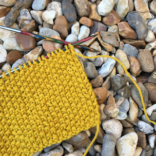 Moss stitch using a mustard aran-weight yarn