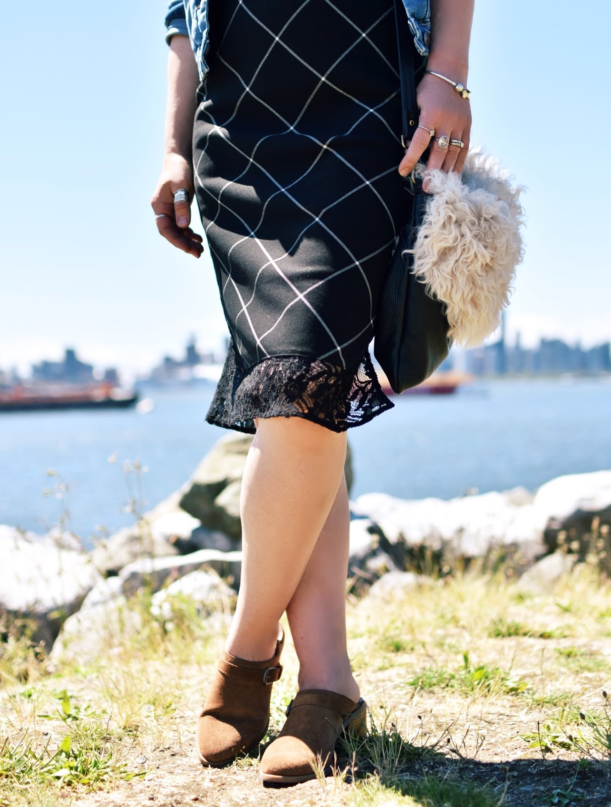 plaid slipdress, western-inspired suede mules, sherpa bag