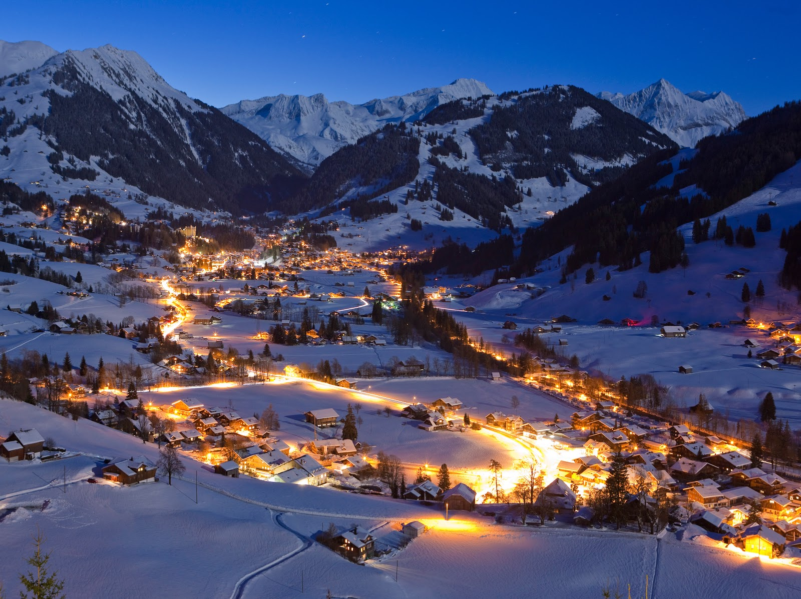 The splendor of Gstaad and the Swiss countryside at dusk. Photo: Gstaad Saanenland Tourismus.